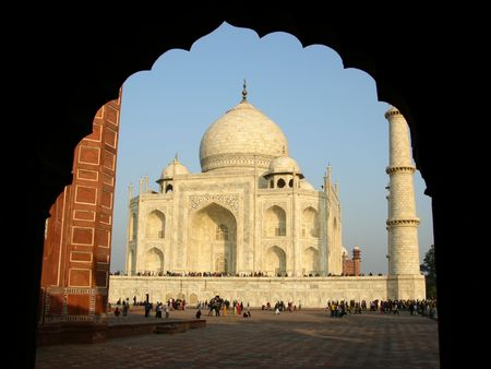 Taj Mahal, viewed from beneath an arch at the mosque Stock Photo - 1304319