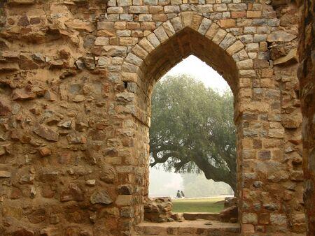 minar: Young people enjoy a quiet moment at Qtub Minar, Delhi, India