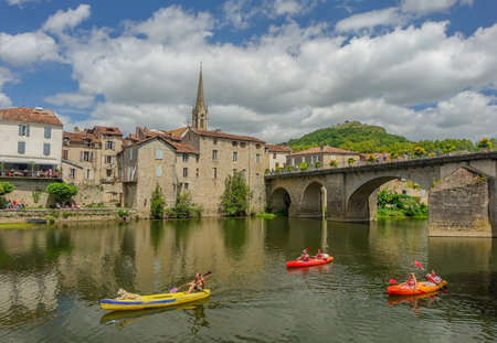 Canoes by the river that passes through Sant Antonin de Noble Val, in the Midi Pyrenees region