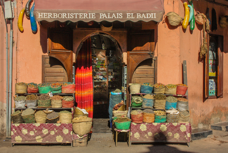 Marrakech, Morocco, Africa - January 14, 2014: Facade herbal shop in Marrakech with different bags at the entrance