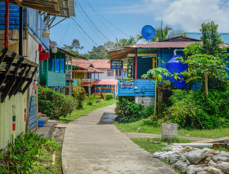 Colorful houses on the main street of Bastimentos Island Editorial
