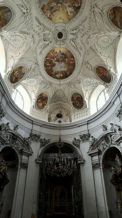 richly: Richly decorated ceiling of church in vienna Stock Photo