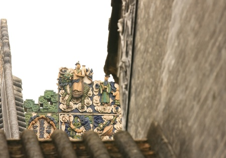 polychrome: Polychrome carving and relief decoration on a roof of a traditional patrician cantoneses house, the Chen Family s home, nowadays the Guangdong Museum of Popular Arts, Guangzhou, Guangdong, China