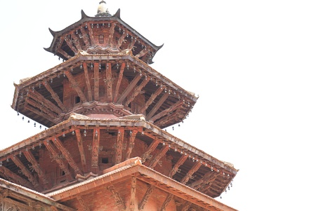 Red brick tower of the Degutalle temple of the Mul Chowk photo
