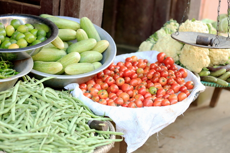 steelyard: Groceries and vegetables shop showing a steelyard and some cauliflower, tomatoes, cucumbers, green beans   in Bandipur-Tanahu district-Gandaki zone-Nepal  Stock Photo