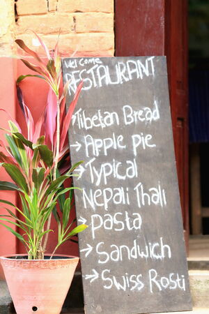 Restaurant advertisement displaying the day s eclectic-international menu  In the main-unique street of Bandipur town-Tanahu district-Gandaki zone-Nepal