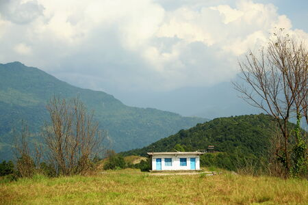 rout: Isolated cottage in the outskirts of Dhampus village at the foothills of the Himalayas on the trek rout surrounding the Annapurnas range  Kaski district-Gandaki zone-Nepal