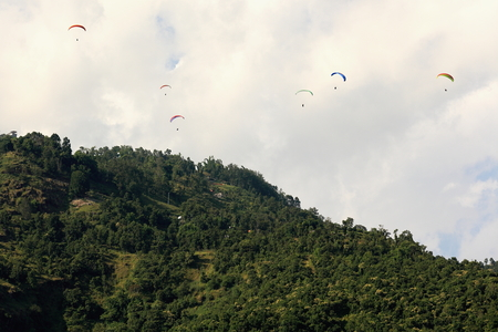 phewa: Paraglides fly the skies over the 5.23 km2 Phewa tal-lake jumping from the lesser slopes of the Annapurnas range on the foothills of the Himalayas. Pokhara-Kaski district-Gandaki zone-Nepal.