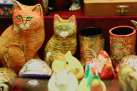 shopwindow: Nepalese handicraft-polychrome paper mache pots and figurines depicting cats-rabbits-hens. Shopwindow of store selling local traditional crafts in a street of Pokhara city-Kaski distr.-Gandaki zone-Nepal. Stock Photo