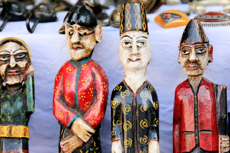 anthropomorphous: Carved traditional wooden figurines colorfully painted set for sale in the windowshop of a store on Lakeside Street. Pokhara-Kaski district-Gandaki zone-Nepal.
