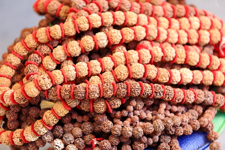osier: Traditional nepalese rudraksha seed necklace on multicolored old typical wicker chair in the Patale Chhango-Devi.s Falls-Hell.s Falls area. Pokhara-Kaski distr.-Gandaki zone-Nepal. Stock Photo