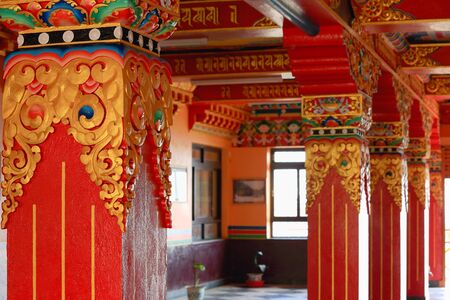 lacquerware: Gilded and colorist decoration on red lacquered columns and chapiters showing traditional buddhist motifs in an inner hall of the 1978 ad-V.V.Khenchen Thrangpu Rinpoche founded Thrangu Tashi Yangtse Monastery. Namo Buddha-Kavrepalanchok distr.-Bagmati zon