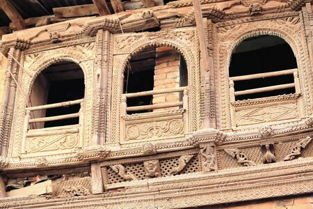 gazer: Profusely carved-traditional newar style-beautiful wooden triple balcony in the old city area. Dhulikhel-Kavrepalanchok distr.-Bagmati zone-Nepal.