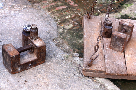 Traditional weighing device-metallic scales with iron chains ang dumbbells on the floor. Th Street in old city area of ??Dhulihel-Kavrepalanchok distr.-Bagmati zone-Nepal.