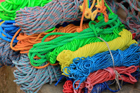 raffia: Manycolored synthetic raffia hanks at the door of a shop in a street of the old city area. Panauti-Kavrepalanchok dstr.-Bagmati zone-Nepal.