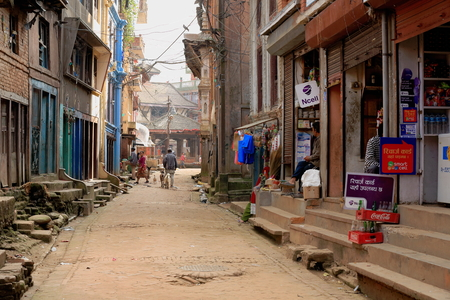 old items: PANAUTI, NEPAL - OCTOBER 16: Shops open to the street in the old city area show their items for sale to the local people on October 16, 2012 in Panauti-Kavrepalanchok dstr.-Bagmati zone-Nepal.