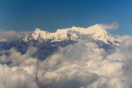 lofty: Aerial view of the snowcapped Himalayas mountain range with Imja Tse-Island Peak at 6189 ms.seen from plane on flight Kathmandu-Lhasa. Nepal-Tibet A.R.-China.
