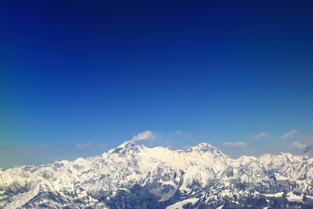 snowcapped: Aerial view of the snowcapped Himalayas mountain range with Cho Oyu at 8201 ms.and Gyachung Kang at 7952 ms.seen from plane on flight Kathmandu-Lhasa. Nepal-Tibet A.R.-China. Stock Photo