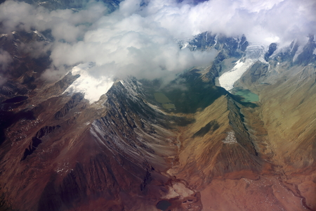 air view: Air view of the snowcapped Himalayas mountain range with glaciers and lakes on the tibetan side from plane on flight Kahtmandu Nepal-Lhasa Tibet. China. Stock Photo