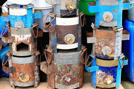 hermetic: Old rusty hermetic metal packages at the entrance to a shop in a street of the old city area. Panauti-Kavepalanchok dstr.-Bagmati zone-Nepal Stock Photo