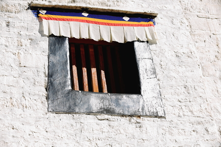 Window on the white washed walls of the 1416 AD.founded Drepung-Rice Heap monastery of the Gelugpa-Yellow Hat School at the foot of mt.Ghephel. Lhasa pref.-Tibet A.R.-China.
