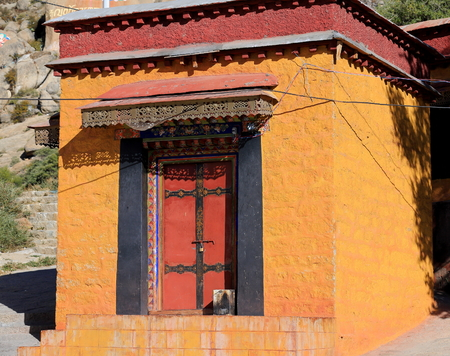 Small orange painted pavilion inside the 1416 AD.founded Drepung-Rice Heap buddhist monastery of the Gelugpa-Yellow Hat School at the foot of mr.Ghephel. Lhasa pref.-Tibet A.R.-China. Stock Photo