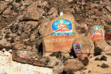 gelugpa: Tibetan buddhist paintings on mani stones -om mani padme hum- in the Drepung-Rice Heap monastery of the Gelugpa-Yellow Hat School at the foot of mount Ghephel. Lhasa pref.-Tibet A.R.-China. Stock Photo