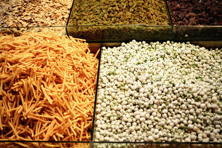 Snacks -watermelon seeds-fried potatoes-raisins-prunes- for sale in a street front shop in the Beijing lam-road. Lhasa-Tibet A.R.-China. photo