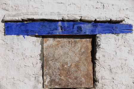 Small window with blue crossbar on the white washed wall of the 1416 AD.founded Drepung monastery of the Gelugpa-Yellow Hat order at the foot of mount Ghephel. Lhasa pref.-Tibet A.R.-China.