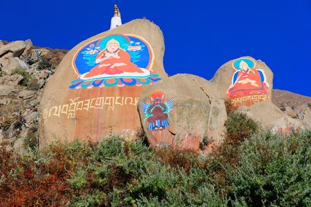 gelugpa: Tibetan buddhist paintings on mani stones -om mani padme hum- in the Drepung-Rice Heap monastery of the Gelugpa-Yellow Hat School at the foot of mount Ghephel. Lhasa pref.-Tibet A.R.-China. Editorial