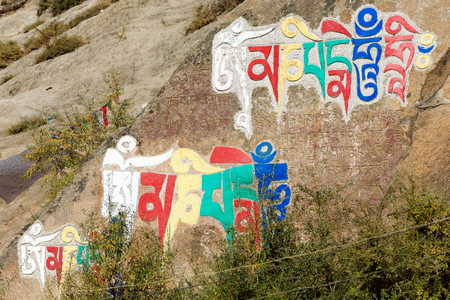 gelugpa: Tibetan buddhist painting on mani stone -om mani padme hum- in the Drepung-Rice Heap monastery of the Gelugpa-Yellow Hat School at the foot of mount Ghephel. Lhasa pref.-Tibet A.R.-China. Editorial