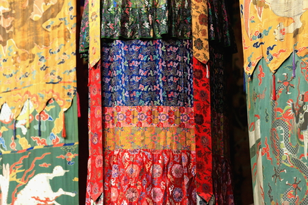 Colorist hanging cloths-tapestry-drape-printed fabric in the 183 pillars and 1850 m2 Sutra Hall of the Coqen Hall building in the Drepung-Rice Heap monastery of the Gelugpa-Yellow Hat order. Foot of mt.Ghephel-Lhasa pref.-Tibet.