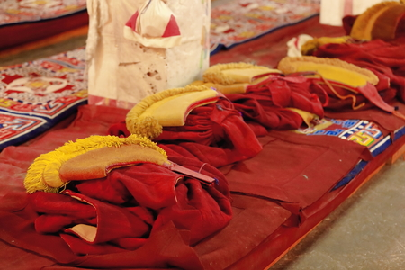 sutra: Red gowns and yellow hats of the monks in the 183 pillars and 1850 m2 Sutra Hall of the Coqen Hall building in the Drepung-Rice Heap monastery of the Gelugpa-Yellow Hat order. Foot of mt.Ghephel-Lhasa pref.-Tibet.
