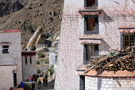 gelugpa: DREPUNG, TIBET, CHINA - OCTOBER 19: Tibetan devotees come to pray to the Coqen Hall of the Drepung-Rice Heap monast.on October 19, 2012. Tibet-China.