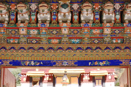 polychrome: Polychrome carved wooden gateway to the 1755 AD.built Kelsan Phodrang-Old Summer Palace in the 3.6 km2 Norbulingka-Jewelled Park complex. Lhasa-Tibet. Editorial