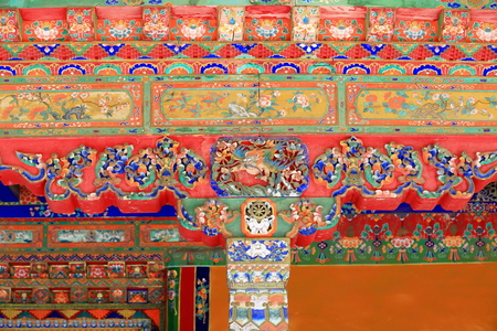 lintel: Polychrome carved woden column-chapiter-rafters of gateway to a pavilion in the 3.6 km2 Norbulingka-Jewelled Park complex. Lhasa-Tibet.