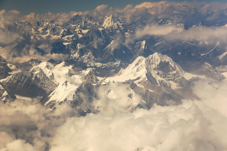 sight seeing: Aerial view of the snowcapped Himalayas mountain range with several peaks over 7000 ms.high seen from plane on flight Kathmandu-Lhasa. Nepal-Tibet A.R.-China. Stock Photo