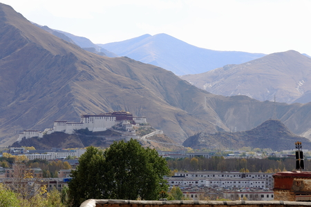 The north side of the Potala palace over Lhasa city as seen from the Gelugpa-Yellow Hat buddhist order Sera-Wild Roses gonpa-monastery. Lhasa pref.-Tibet A.R.-China.