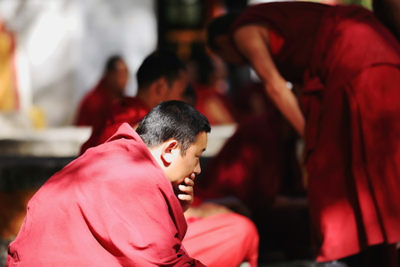 learning process: SERA, TIBET, CHINA - OCTOBER 19: Monks debate on doctrine-part of learning process for better comprehension of philosophy. Sera-Wild Roses monastery of the Gelugpa-Yellow Hat order on the slope of Pubuchok mountain. Lhasa pref.-Tibet A.R.-China.