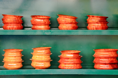 tibet bowls: Tibetan pottery-polished bowls piled on green wooden shelves. Street shop on the Kora-clockwise circumambulation circuit around the Jokhang-House of Buddha temple. Lhasa city and prefecture-Tibet A.R.-China. Stock Photo