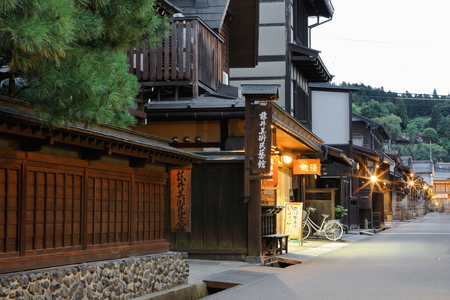 street lamp: Traditional houses in a street of the old city area at twilight. Takayama-Gifu prefecture-Chubu region-Japan.