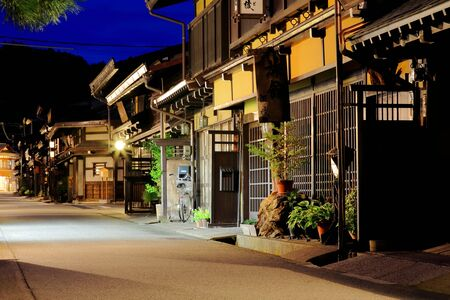 townhome: Traditional houses in a street of the old city area at night-twilight. Takayama-Gifu prefecture-Chubu region-Japan.