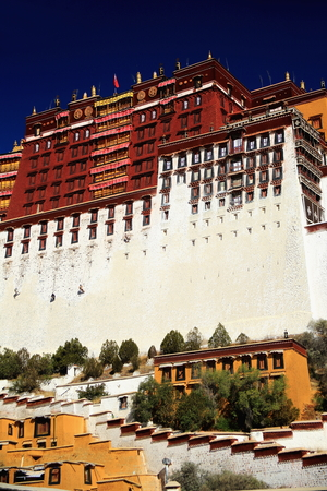 surrounding wall: Potala palace with the Potrang Marpo-Red Palace to the west and surrounding wall at 3700 ms.high over Marpo Ri-hill overlooking Lhasa town. Tibet A.R.-China.