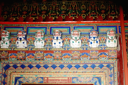 lintel: Colorist wood carved door lintel depicting tibetan traditional decoration: white snow lions-lotus flowers. Potala palace-Lhasa city and prefecture-Tibet A.R.-China. Editorial