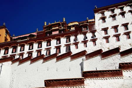 hill of the king: Buildings on the grounds of the Potala palace with the Potrang Marpo and Karpo-Red and White Palaces to the W.and E.at 3700 ms.high over Marpo Ri-hill overlooking Lhasa town. Tibet A.R.-China.