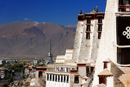 tibetan house: LHASA, TIBET, CHINA - OCTOBER 20: Tibetan workers whitewash the walls in the Potala palace while some locals get to visit the monument on October 20, 2012 in Lhasa-Tibet A.R.-China