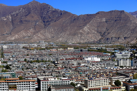 View over Lhasa city to the N.of the Potala palace including the Potrang Karp and Marpo-White and Red palaces on Marpo Ri-Red Hill risaing 300 ms.over Lhasa-Tibet.