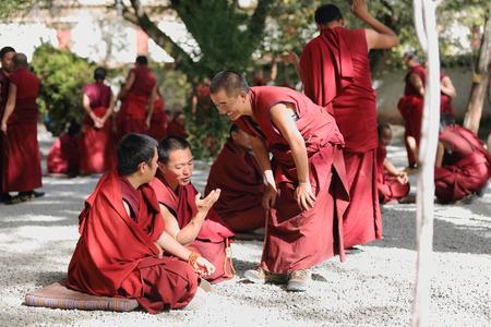 gelugpa: SERA, TIBET, CHINA - OCTOBER 19: Monks debate on doctrine-learning process-better comprehension of philosophy on October 19, 2012. Sera-Wild Roses monast.of Gelugpa-Yellow Hat order. Pubuchok mountain slope-Lhasa pref.-Tibet-China.
