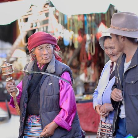 fervor: LHASA, TIBET, CHINA - OCTOBER 19: Tibetan buddhist devotees do the Kora-clockwise circumambulation around the Jokhang-House of Buddha temple on October 19, 2012 in Lhasa-Tibet. Editorial