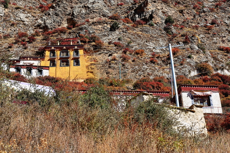 orison: Buildings of the Drak Yerpa monastery perched on the southwards facing slope of the mountaincomplex of more than 80 meditation caves. Lhasa pref.Tibet A.R.China.